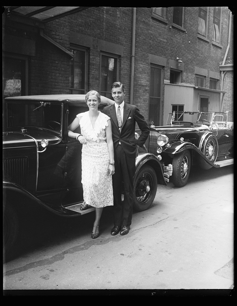 Young woman and man at automobile